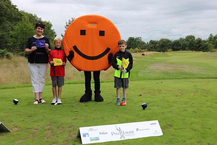 Sheena Anderson of AABi with Fletcher Riach & Riley Reid (right) taking part in the Grass Roots golf programme at the Paul Lawrie Foundation.