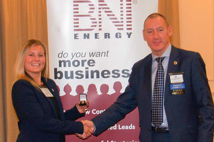 Angela Kinghorn, BNI Scotland North director, and Graham McWilliam, CEO at social enterprise Glencraft, with the millionaires pin badge