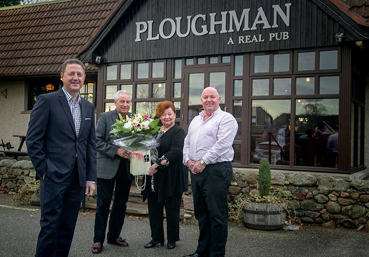 From left, Alistair Dornan, Graeme and Shirley Wight, and Simon Cruickshank. New owners Alistair and Simon presented the Wights with flowers and a bottle of red wine.