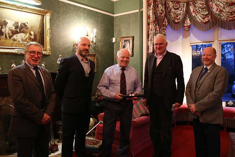 Jim Milne, centre, receives his Honorary Fellowship from RIAS president Robin Webster, second right.