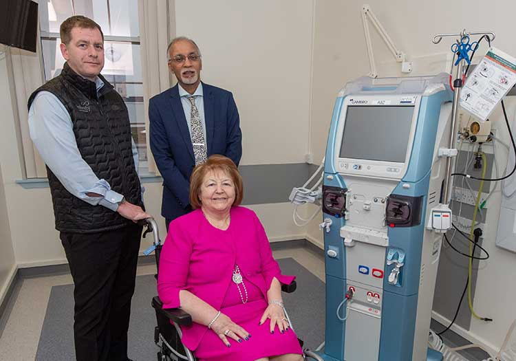 From left, Simon Cowie, managing partner at Infinity Partnership, and Dr Izhar Khan, NHS Grampian consultant nephrologist, and Hiezel Cowie, next to one of the new dialysis machines at Aberdeen Royal Infirmary