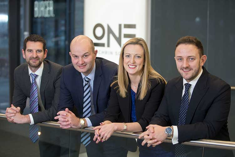 Senior Dealmakers at Anderson Anderson & Brown LLP, from left to right: Brian McMurray, Douglas Martin, Lyn Calder & Chris Thompson.