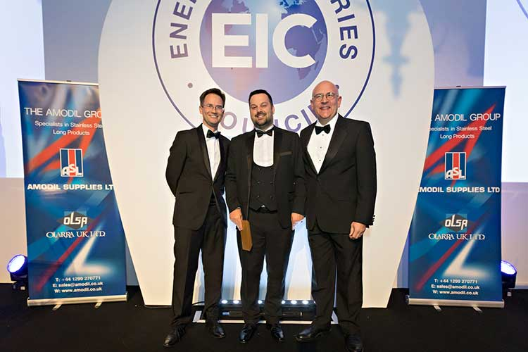 Brian Geddes (centre) receiving his award