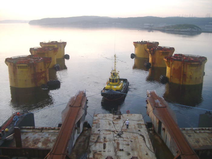 The Hutton Tension Leg Platform (TLP) the first ever production TLP, was bought by Sevmorneftegaz in 2002, departed the East Shetland Basin and towed to Murmansk. The 19,000 tonnes topsides was de-mated from the pontoon (pictured) with ultimate repositioning on to a caisson on the Prirazlomnoe project, the first ever Russian offshore Arctic oil field to be put in production.